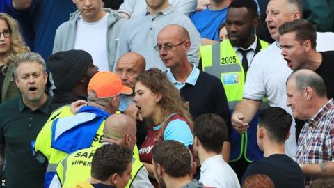Fans confront stewards during West Ham's game against Middlesbrough