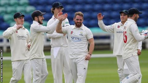 Glamorgan celebrate a David Lloyd wicket against Cardiff MCCU