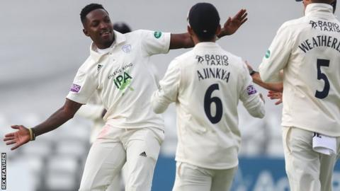 Fidel Edwards celebrates taking a wicket with his Hampshire teamamtes