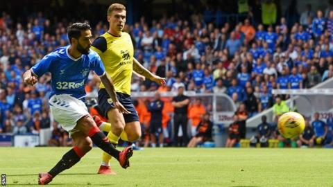 Rangers' Daniel Candeias (left) scores against Oxford United