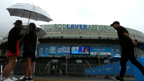 Rain has held up play on day five at the Australian Open