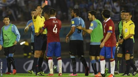 Red card shown after final whistle of World Cup qualifier between Chile and Uruguay