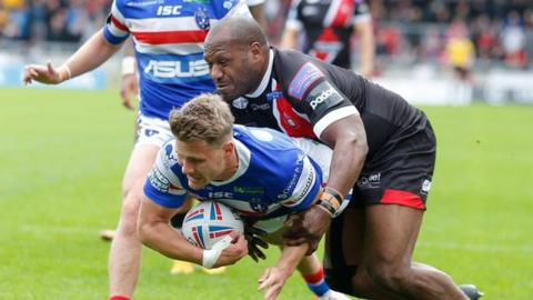 Wakefield's Jacob Miller (left) and Salford's Rob Lui both got on the scoresheet at the AJ Bell Stadium