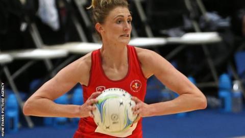 Kelly Morgan of Wales prepares to make a pass