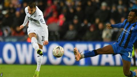 Swansea midfielder Bersant Celina lets fly to score in the FA Cup win over Gillingham