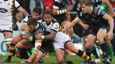 Stuart McCloskey is tackled by Danny Cipriani at Kingspan Stadium