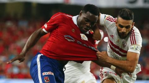 Zamalek's Ahmed Dwedar (right) vies with Al Ahly's Malik Evona