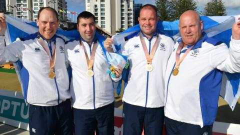 Scotland fours team Ronald Duncan, Derek Oliver, Paul Foster and Alexander Marshall with gold medals