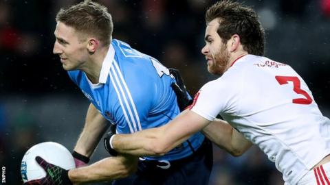 Dublin forward Eoghan is tackled by Tyrone's Ronan McNamee in Saturday night's league clash