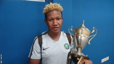 Nigeria captain Rita Chikwelu with Women's Africa Cup of Nations trophy