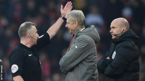 Arsenal manager Arsene Wenger (centre) is sent to the stands by referee Jon Moss during the game against Burnley