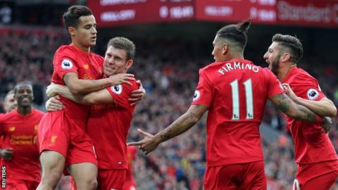 Liverpool players celebrate James Milner's (second from left) converted penalty