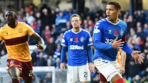 Rangers' James Tavernier (right) shows his frustration after missing a first-half penalty against Motherwell
