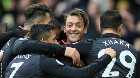 Mesut Ozil (centre) celebrates with team-mates