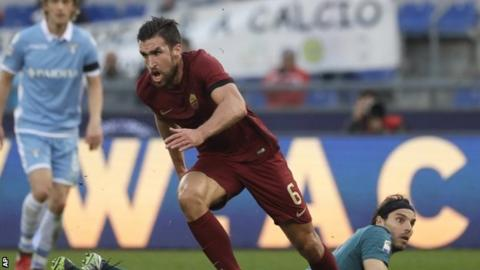 Kevin Strootman celebrates after giving Roma the lead against Lazio