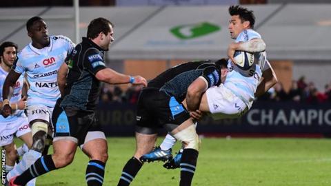Racing 92 fly-half Dan Carter is tackled by Glasgow centre Alex Dunbar