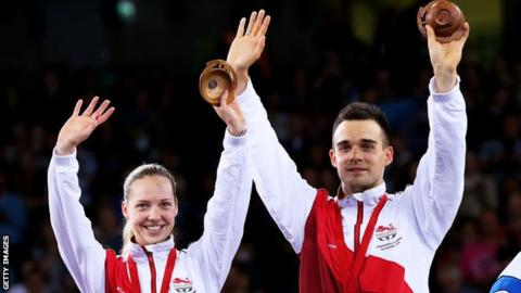 Chris and Gabby Adcock celebrate with Commonwealth medals