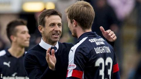 Neil McCann celebrates with Dundee striker Craig Wighton