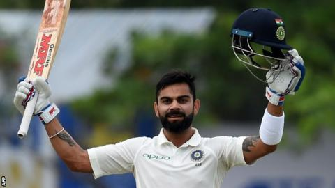 Virat Kohli celebrates hitting a century