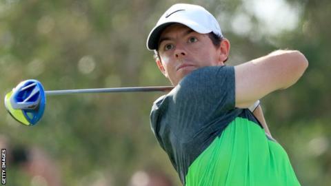 Rory McIlroy hits his tee shot at the ninth on Saturday