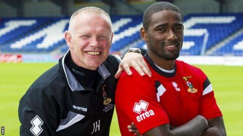 John Hughes with Inverness signing Nathaniel Wedderburn