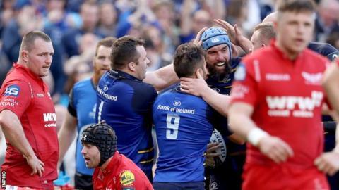 Leinster celebrate Scott Fardy's try as Scarlets despair