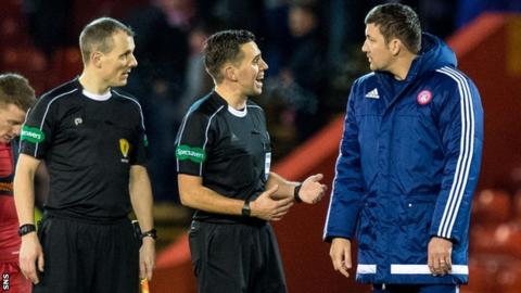 Martin Canning speaking to referees