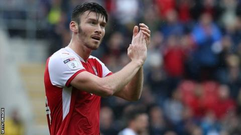 Kieffer Moore applauds the Rotherham fans as he is substituted against Northampton