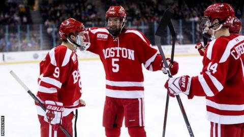 Logan Cockerill celebrates scoring for Boston University against University of Connecticut
