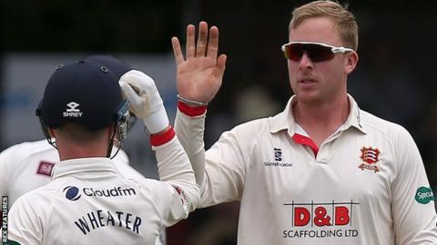 Simon Harmer celebrates a wicket for Essex with Adam Wheater
