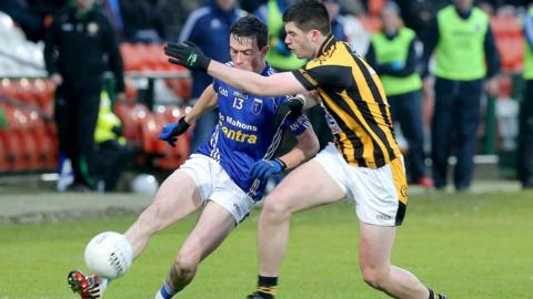 Scotstown attacker Shane Carey gets his pass away despite the challenge coming in from Crossmaglen's Aidan Rushe