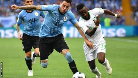 Uruguay lead 2-0 against 10-man Russian Federation  in Group A decider