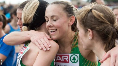 Kerry O'Flaherty embraces Ireland team-mates Lizzie Lee and Fionnuala McCormack after the recent team bronze success at the European Cross Country Championships