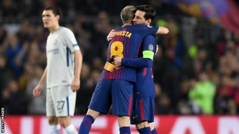 Andres Iniesta of Barcelona hands the captain's armband to Lionel Messi