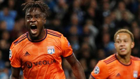 Maxwel Cornet celebrates scoring for Lyon against Manchester City