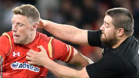 New Zealand's Dane Coles tackles Rhys Priestland
