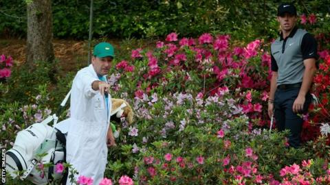Rory McIlroy tries to plot a route out of Augusta's famous azaleas in 2014