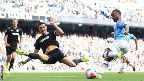Raheem Sterling shoots against Brighton