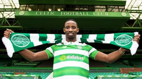 Moussa Dembele with a Celtic scarf