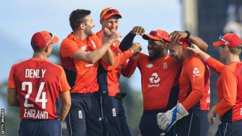England players celebrate taking a wicket