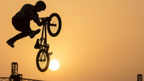 A rider performs during the BMX freestyle parc pro final in Jeddah