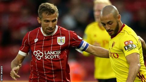Bristol City's Gary O'Neil challenges Watford player Nordin Amrabat for the ball