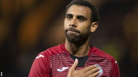 Anton Ferdinand taps the badge on his shirt after St Mirren's 1-1 draw at Dundee
