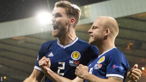 Stephen O'Donnell and Steven Naismith celebrate a Scotland goal against Albania