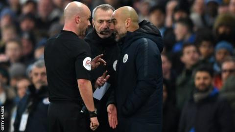 Referee Anthony Taylor (left) speaks to Manchester City boss Pep Guardiola (right) as fourth official Martin Atkinson (centre) looks on during City's 2-1 win over Liverpool