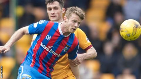 Alex Fisher in action against Motherwell