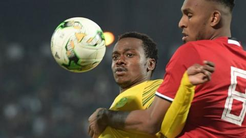 South Africa Percy Tau vies for the ball with Libya's defender Sanad Al-Warfali in March