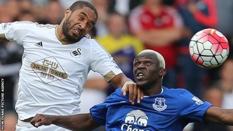 Swansea's Ashley Williams (left) challenges Arouna Kone of Everton during the two sides' 0-0 draw in September 2015