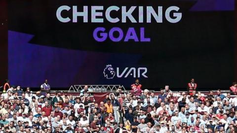 A screen announcing VAR decision