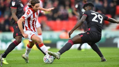 Joe Allen carries the ball forward for Stoke City
